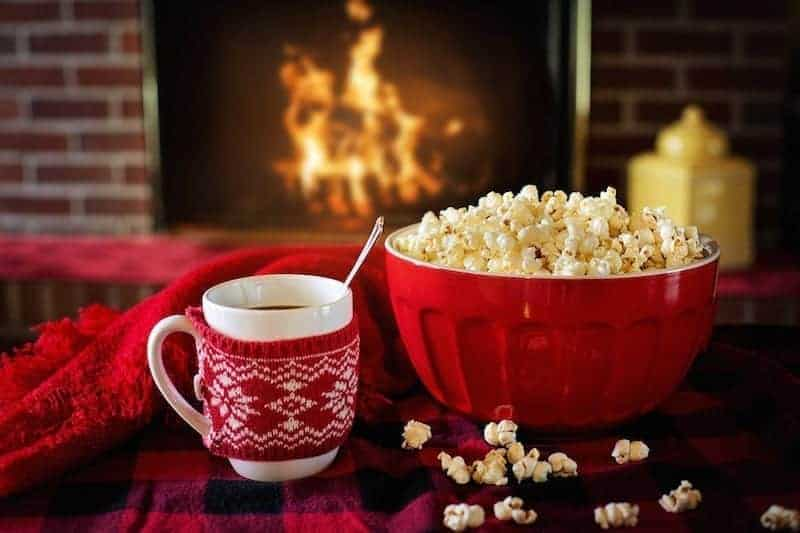 Hot Coco and Popcorn Being Enjoyed Next to a Warm Fire