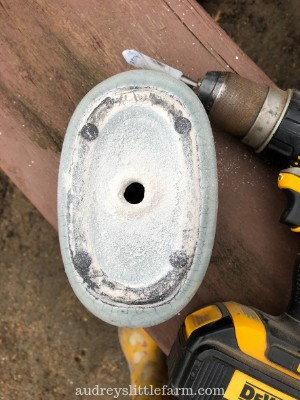 A Garden Pot With a Drain Hole Next to a Drill
