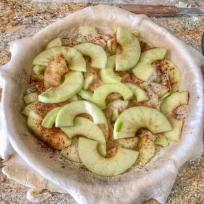 Sliced Apples in the bottom of a Homemade Pie Crust