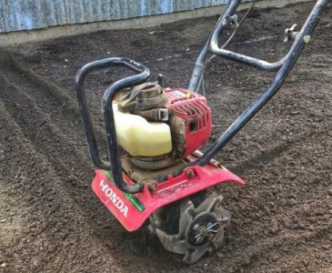 A Rototiller in the Garden to Prepare the Beds for Planting
