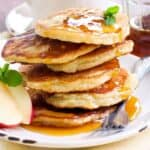 Apple Cinnamon Pancakes on a Plate With Maple Syrup
